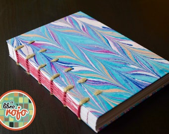 Wonderful handmade journal with cords, pack and weave stitch, marbled cover.