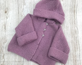Hand knitted baby coat with hood