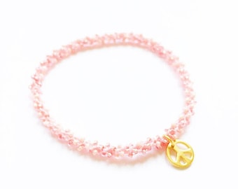 Golden peace charm stackable beaded crochet peachy coral blush pink yoga friendship bracelet