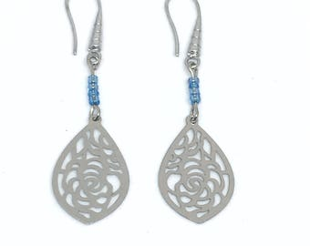 Filigree earrings and turquoise seed beads.