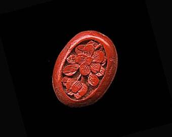 Carved cinnabar oval cabochon. 19x15mm. Pkg of 1. b5-498(e)