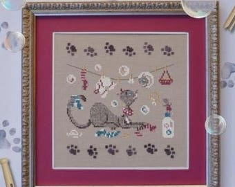 Cat Collection – series of 8 counted cross stitch cat charts. Chart and key in French.  Cats in different settings, whimsical cats and paws.
