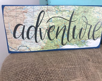 Adventure  wood map sign