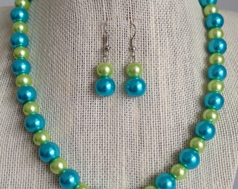 blue l by green bib statement necklace and