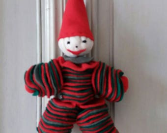 Red and green felt puppet hanging