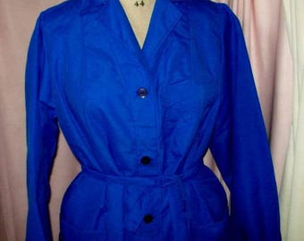 A vintage, dark blue nylon blouse