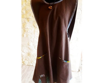 Brown Linen Apron Dress with screen printed design & pocket detail.