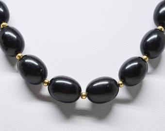 Large black tone beaded necklace