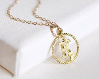 the letter K (10k gold) // vintage gold initial necklace . tiny initial necklace . gold initial necklace . solid gold . 10k gold necklace
