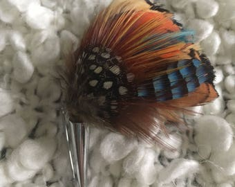 Beautiful and colourful feather brooch