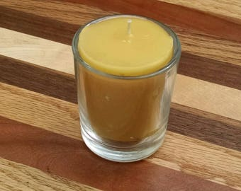 Beeswax votive candle in glass holder