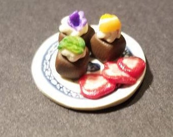Dollhouse style Miniature Chocolate Petit Four Trio garnished with sliced strawberries