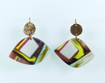 Swinging Sisters: handmade contemporary resin drop earrings striking contrast colours, red, yellow, black and transluscent white