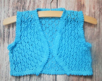 Young little girl's lacy diamond lace stitch hand knitted bright blue summer bolero shrug sleeveless jacket waistcoat original design OOAK