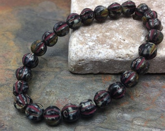 Czech Glass Melon beads 6mm. One unit has 25 beads. Color: black with picasso finish