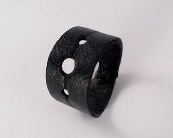 Black leather rings, holes
