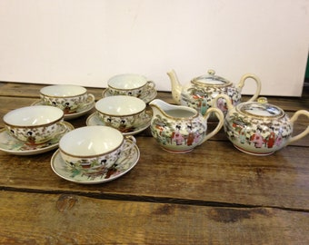 Vintage Amazing Japanese Nippon Teaset, Handpainted Raised Decor With A Traditional Floral and Gilt Pattern.