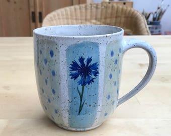 Large mug-cornflower + puff flowers + poppy seeds