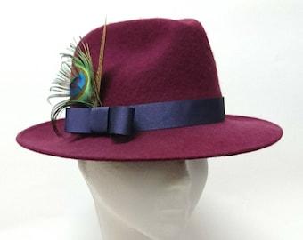 Magenta and purple fedora hat.