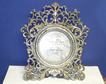 Reduced picture frame, ornate, with glass
