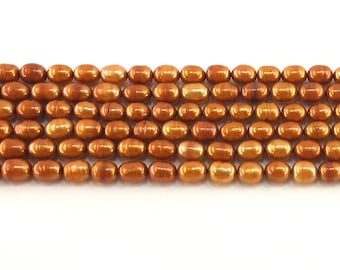 """Copper orange freshwater pearls 6x8mm beads full 15.5"""" strand - banded ringed potato cultured"""