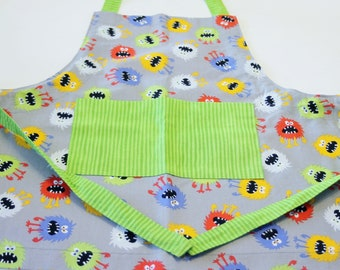 Children's Full Apron in Monster Fabric with Green Patch Pocket - Size 3-8 (approximately) Apron