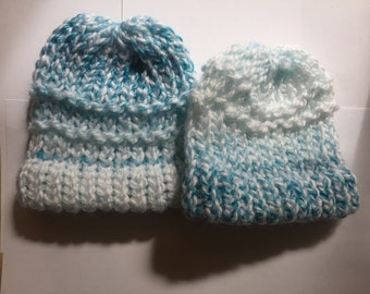 Two baby hats both blue with white
