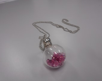 Pink pendant filled with Swarovski crystals glass vial on chain