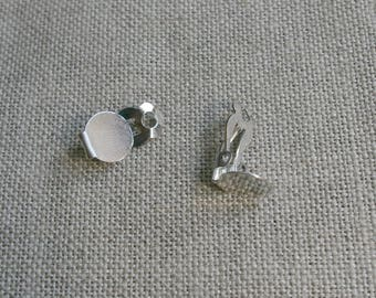 A pair of clip on earrings in silver finish collage