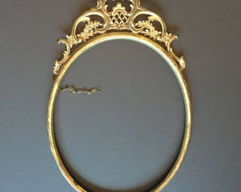 Vintage oval picture frame, gold toned metal, 1910s