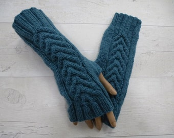 Hand knitted longer length teal wristwarmers with cables. Fingerless gloves