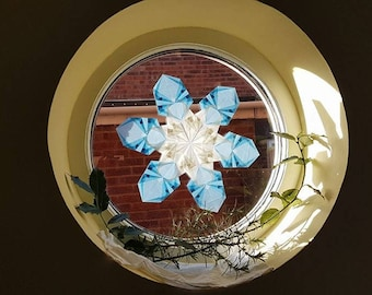 Waldorf winter window star made with strong kite paper