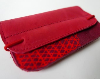 Wallet of bright red leather with silk screenprint