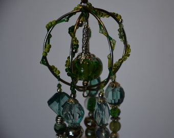If green is your color this various green and silver beaded dangler is for you. 5 srands of pretty hues of green and shiny silver!