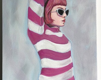 Portrait of a girl in a striped sweater.