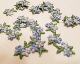 1 Package of 24 Blue embroidered flower applique 3/4 inch