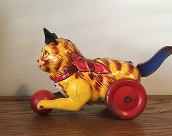vintage Marx tin  litho toy cat with friction driven tail