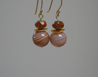 Earrings with gold on silver pendants