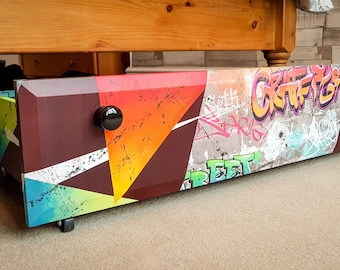 Funky graffiti design upcycled under bed storage drawer