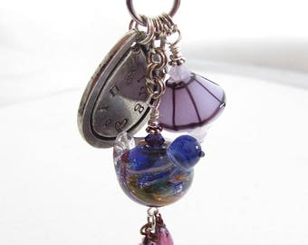 Singing In The Rain, Purple Handstamped Boho Charm Necklace, Pewter Pendant with Handmade Lampwork Glass Bird Bead, Purple and Violet