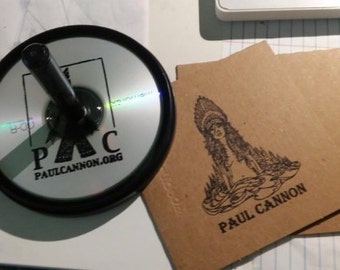 CD Custom Rubber Stamp. Rubber Stamp stamping CDs and CD case. Artwork and business logo.  Brand your Band on CD