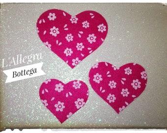 30 felt hearts of three different sizes