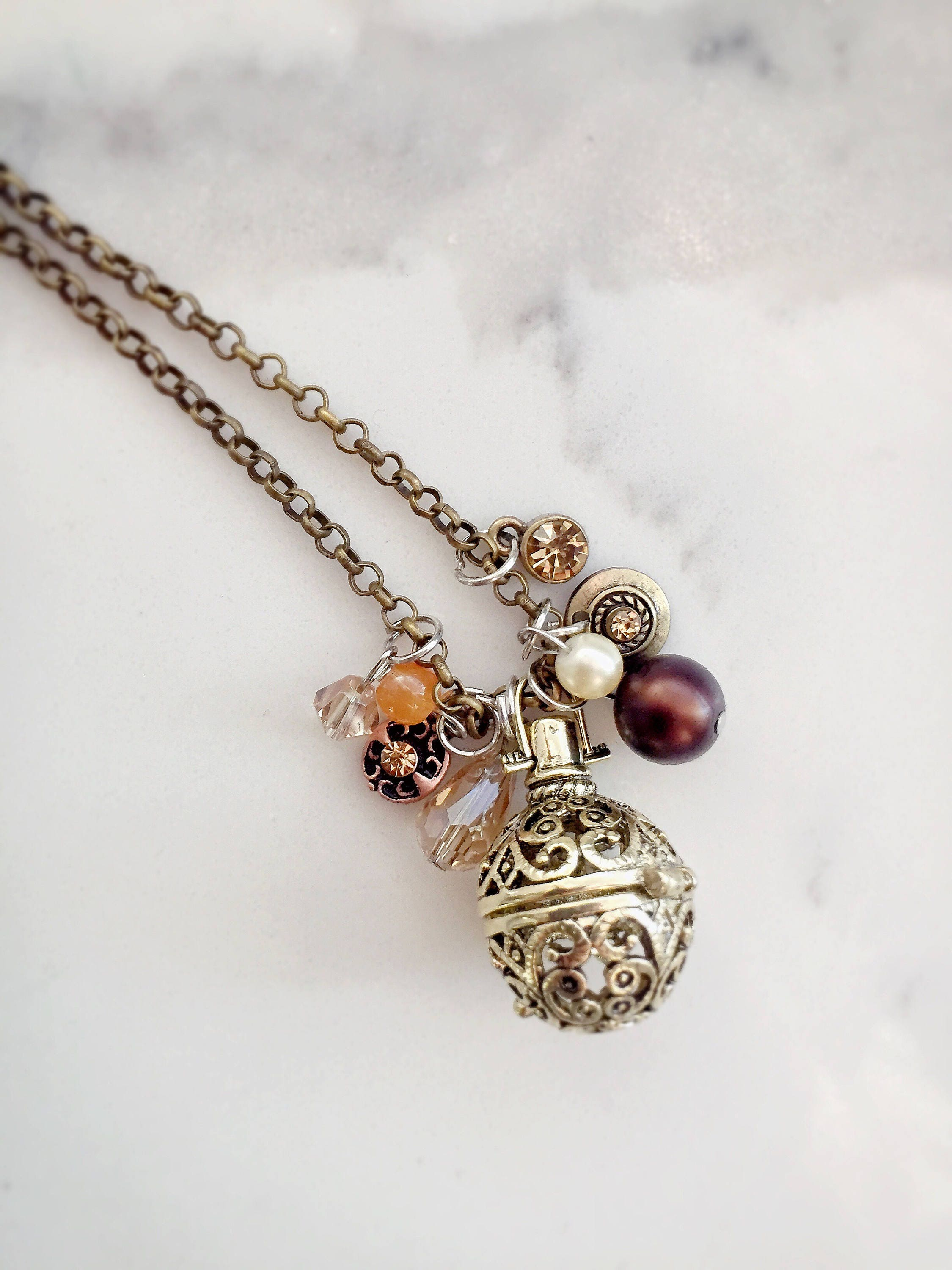 expand bohemian clover rhapsody shop antique locket oil necklace necklaces essential jewellery