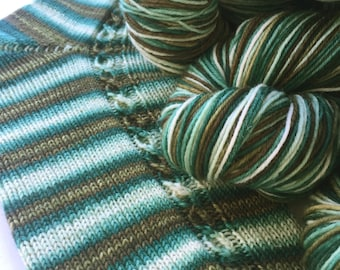 Hand dyed self striping sock yarn - In The Pines