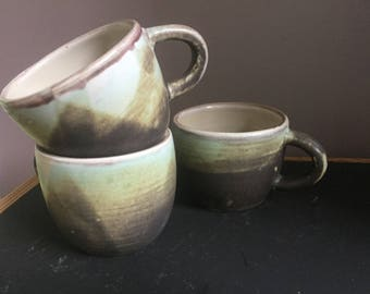 Four wheel thrown mugs. Earthy tones with hints of turquoise.  Made with love and joy.
