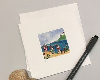 Hand painted blank card, three beach huts and houses on the hill. Free UK delivery.