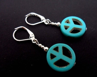 A pair of cute little hand made tibetan silver & turquoise peace sign dangly leverback hook earrings. new.