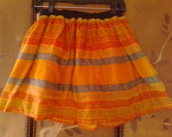 Bright orange patterned sheer mini skirt