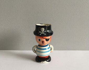 Vintage wooden pirate egg cup.