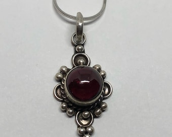 Beautiful Sterling Silver Round Garnet Pendant on a Silver Necklace